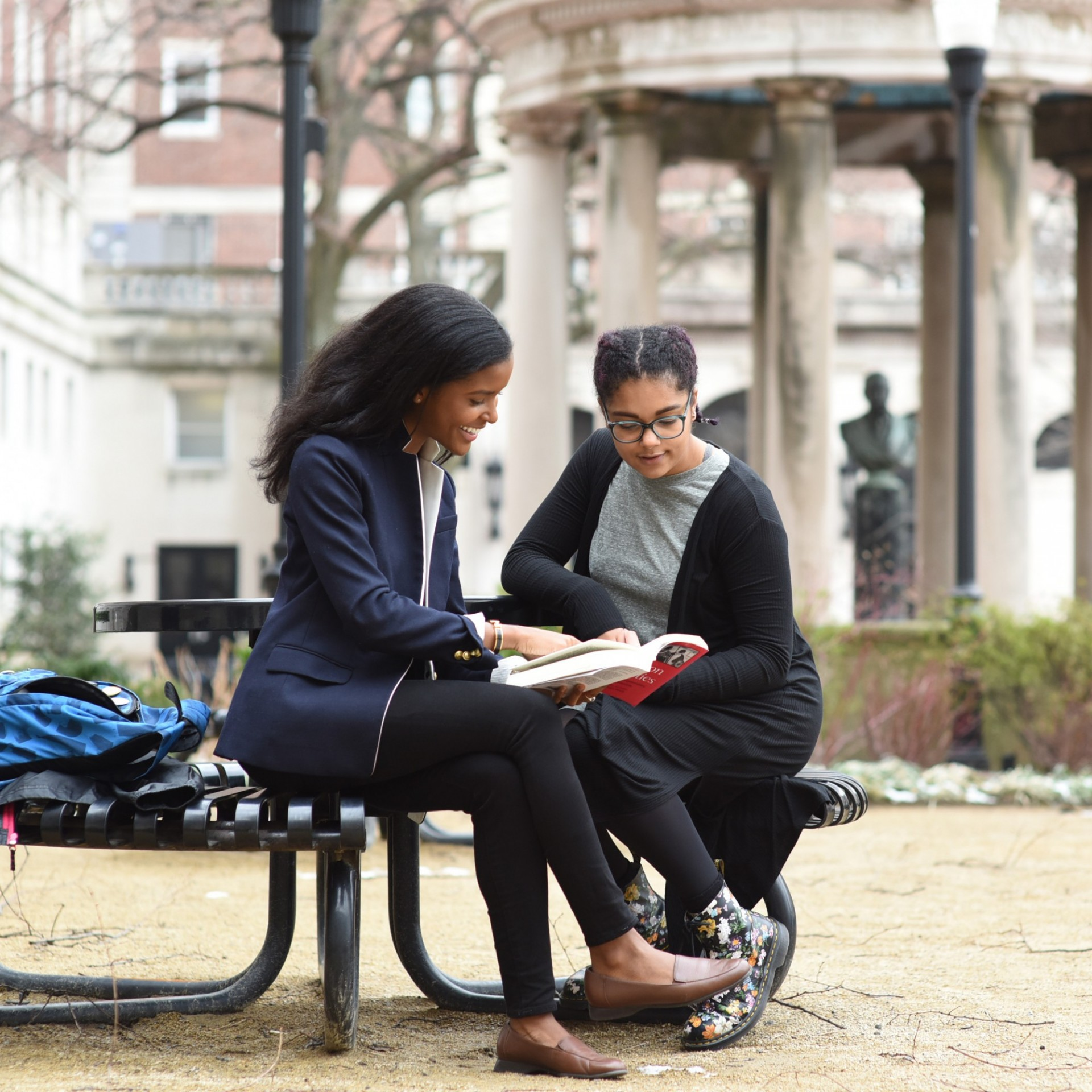 Dual BA students reading on Columbia campus